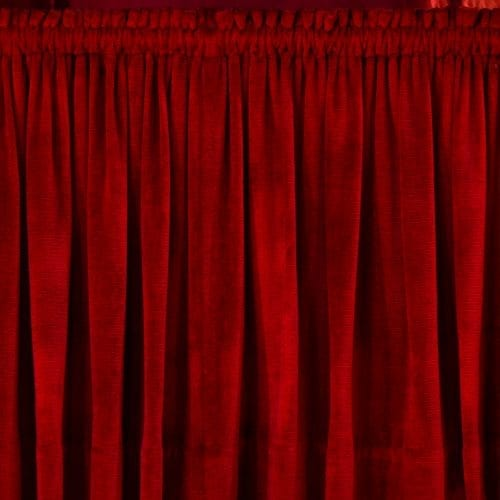 closeup photo of red rod pocket curtain