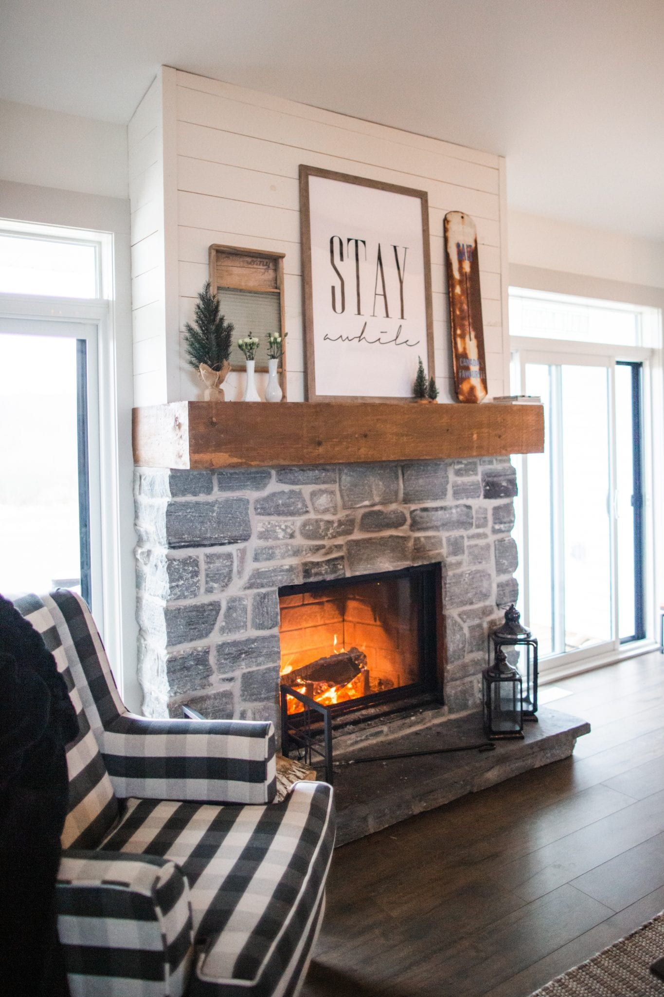 two black sconce lamps near fireplace