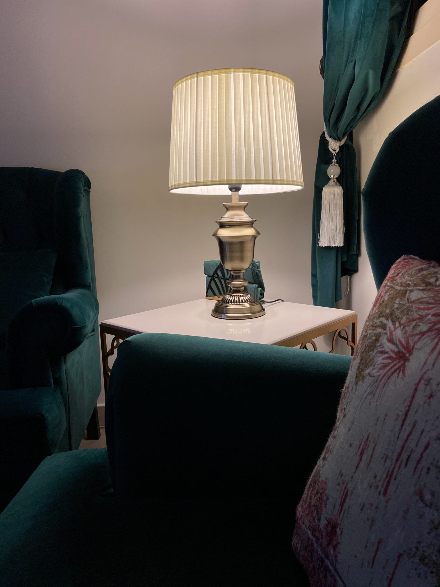 white and gold table lamp on white wooden table