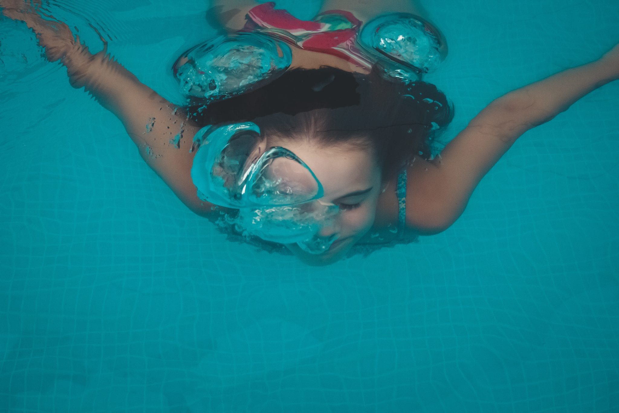 woman swimming under water