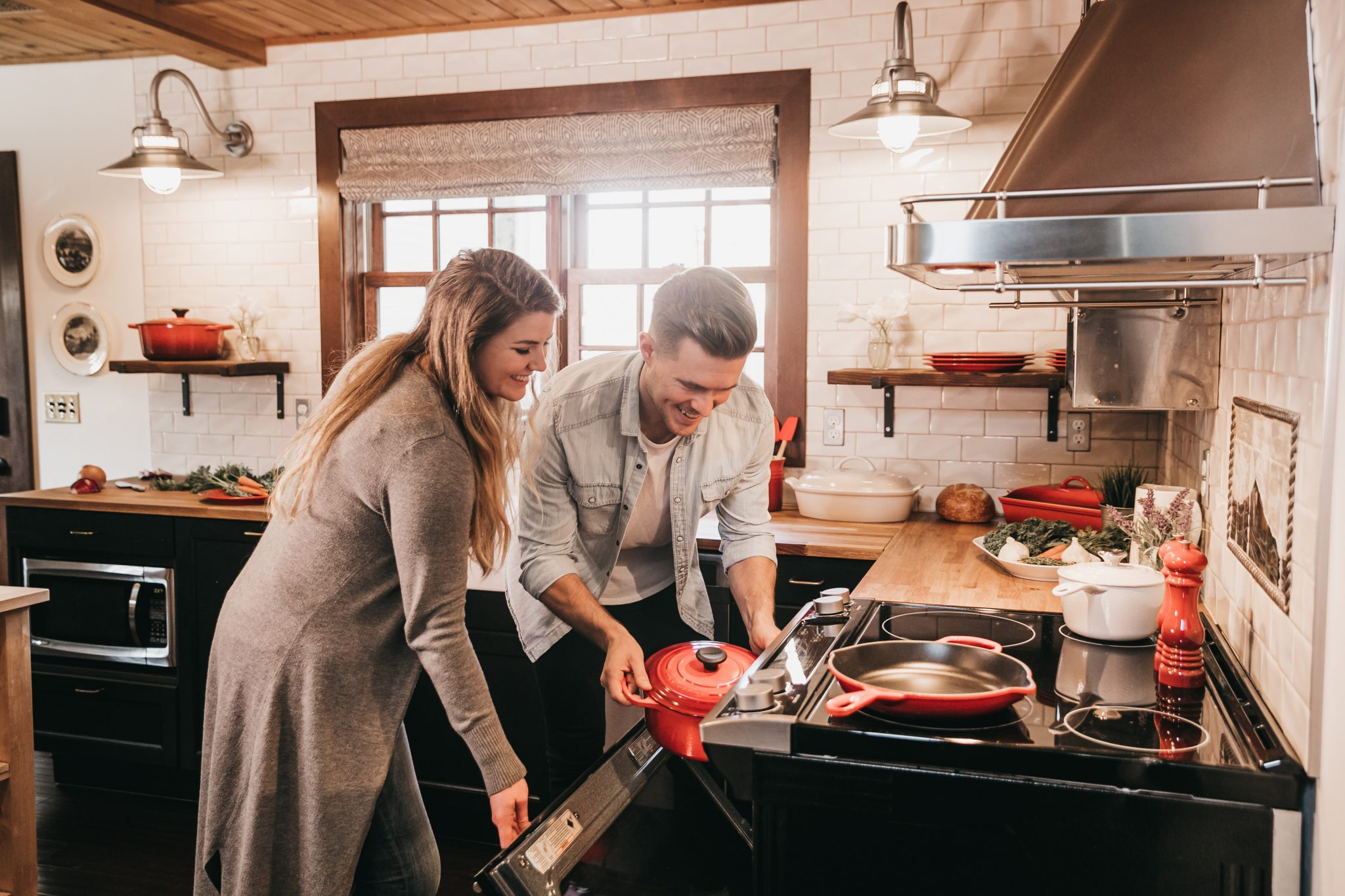man and woman cooking